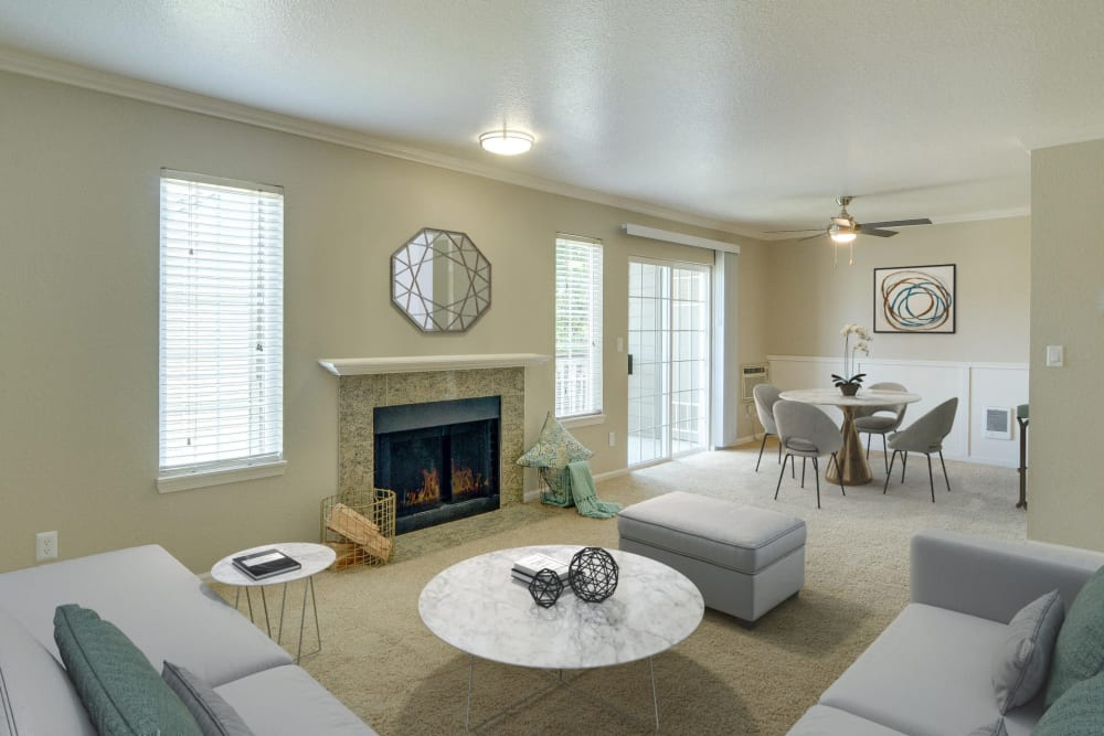 Fireplace and patio access in a living room at Carriage House Apartments in Vancouver, Washington