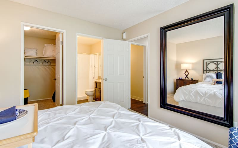 A master bedroom looking into the attached bathroom at Lakeview Village Apartments in Spring Valley, California