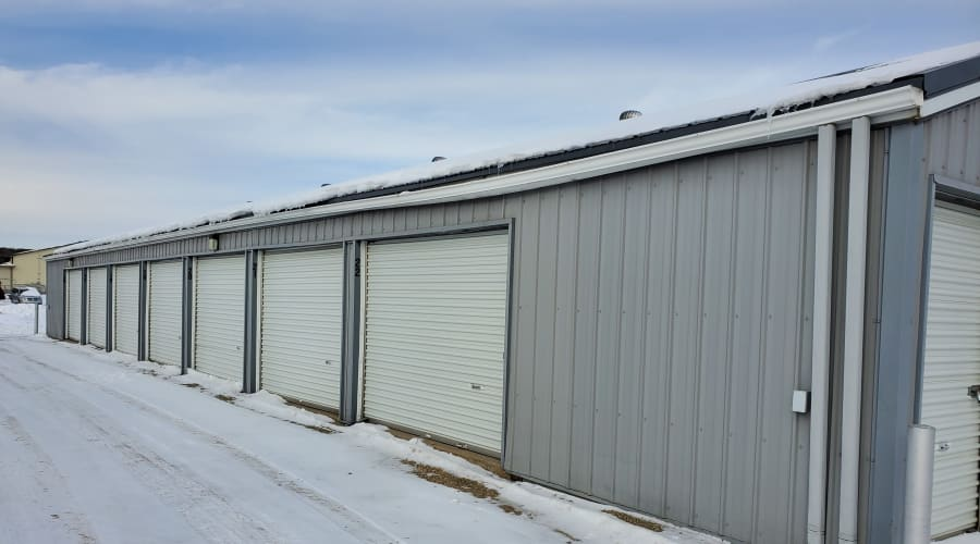 Outdoor storage units with white doors at KO Storage of Waseca 5th St in Waseca, Minnesota