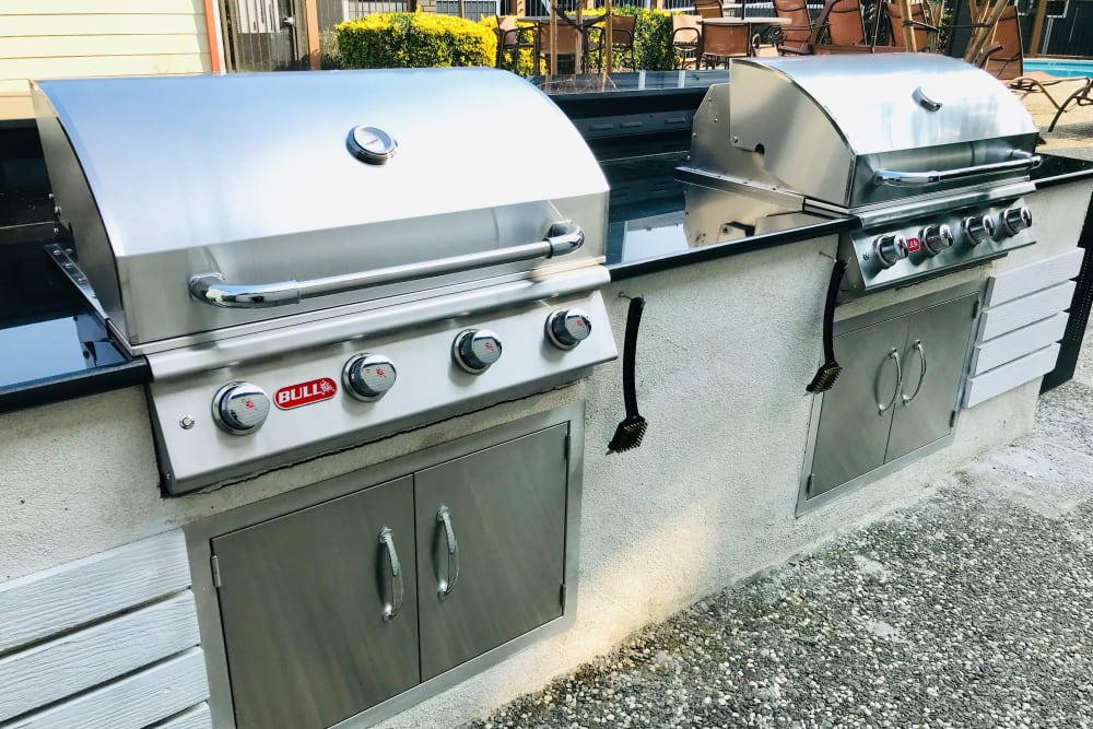 Outdoor barbecues near the pool at Bennington Apartments in Fairfield, California