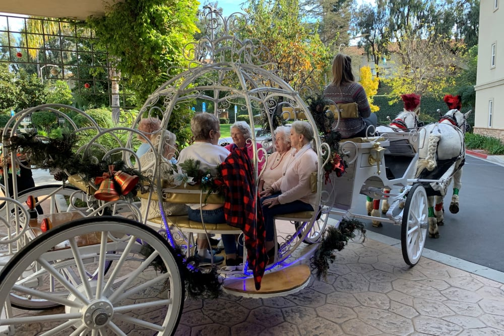 Residents taking a ride in a carriage near Merrill Gardens at Oceanside in Oceanside, California.