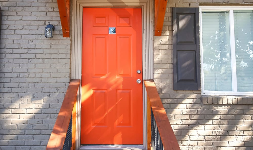 Orange door providing access to resident apartment home at The Broadway at East Atlanta