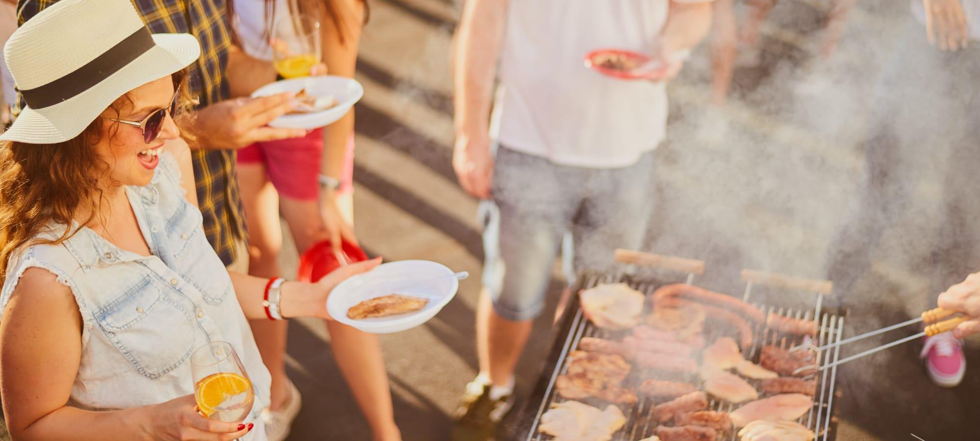 Residents enjoying an outdoor grill at Villa Vita Apartments in Peoria, Arizona