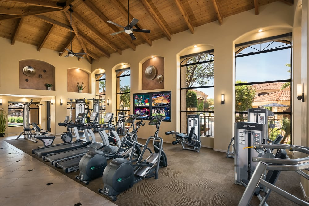 Resident working out in the fitness center at San Lagos in Glendale, Arizona