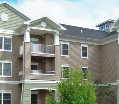 Exterior view of apartment home at Greenwood Cove Apartments in Rochester