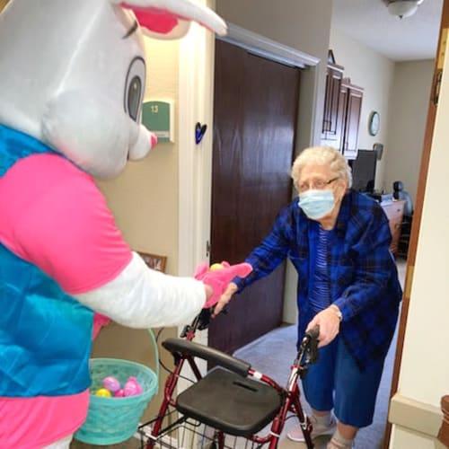 Easter bunny greeting resident at Madison House in Norfolk, Nebraska