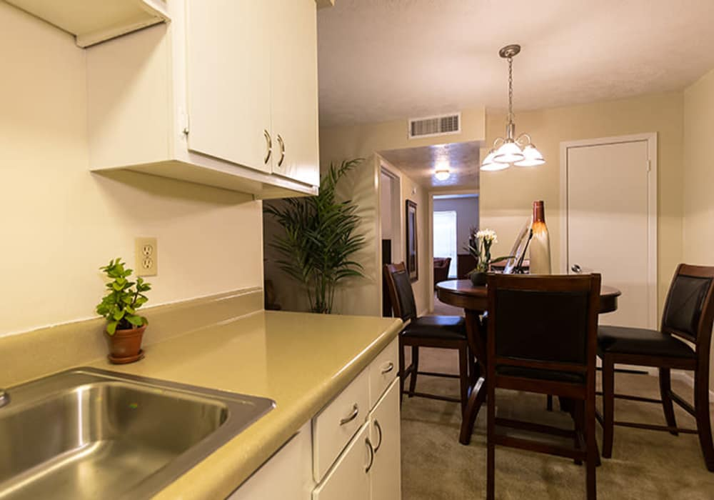 Dining room and kitchen at Riverstone Apartments in Bryan, Texas