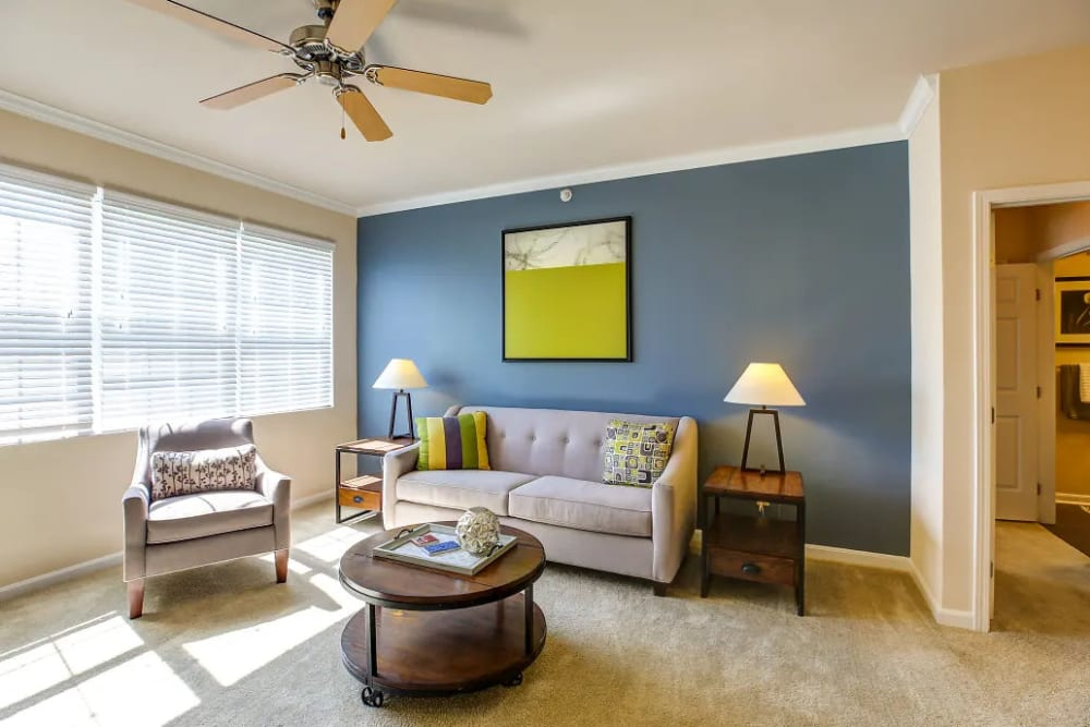 A living room at Charleston Pines Apartment Homes, with modern farmhouse furnishings.
