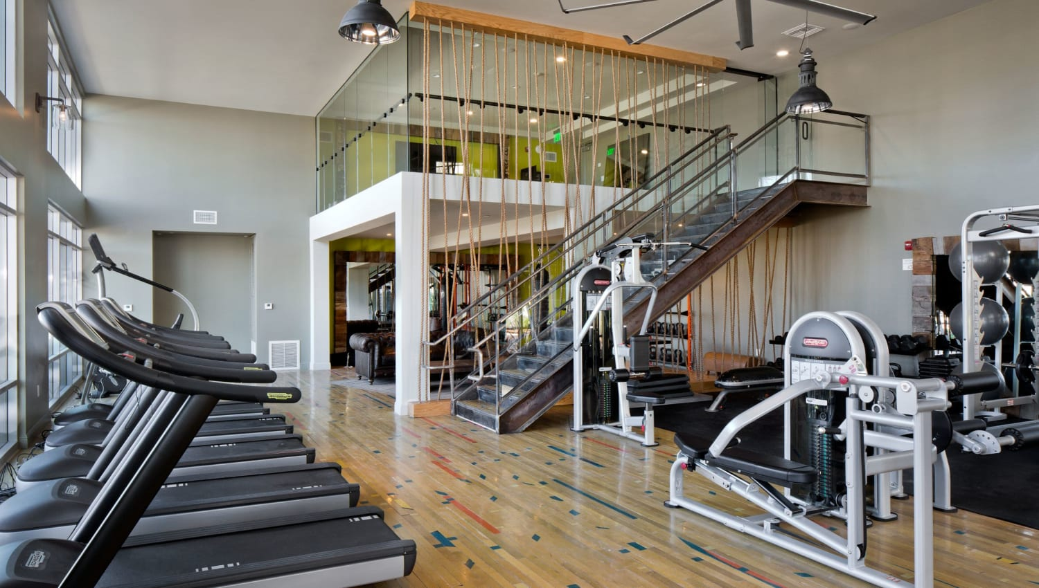 Fitness club equipped with state-of-the-art cardio machines at Olympus Corsair in San Diego, California