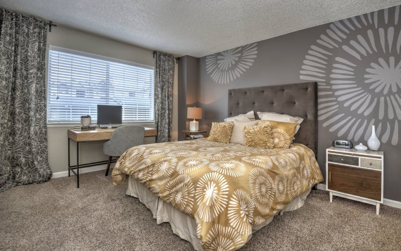 Master bedroom with plush carpeting at Arapahoe Club Apartments in Denver,