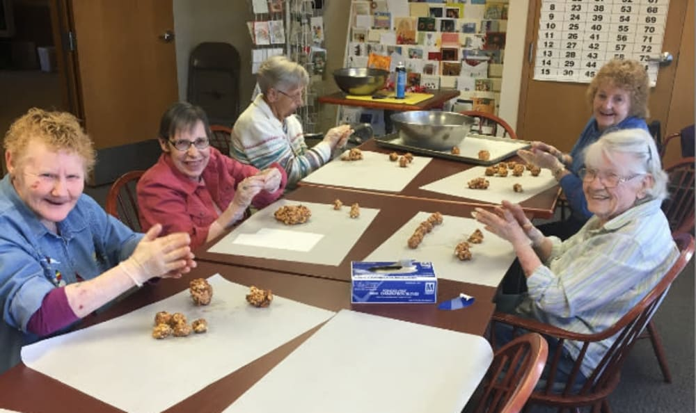 A group of residents make cookies together