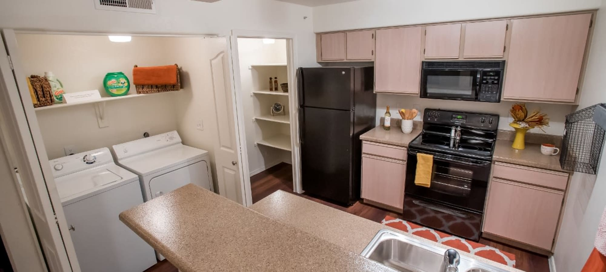 Kitchen and laundry room at The Palms on Scottsdale in Tempe, Arizona