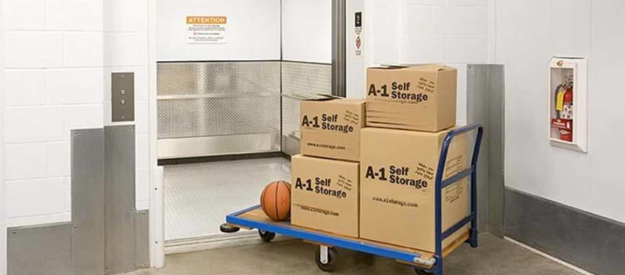 Freight elevator and a loaded cart at A-1 Self Storage in San Jose, California