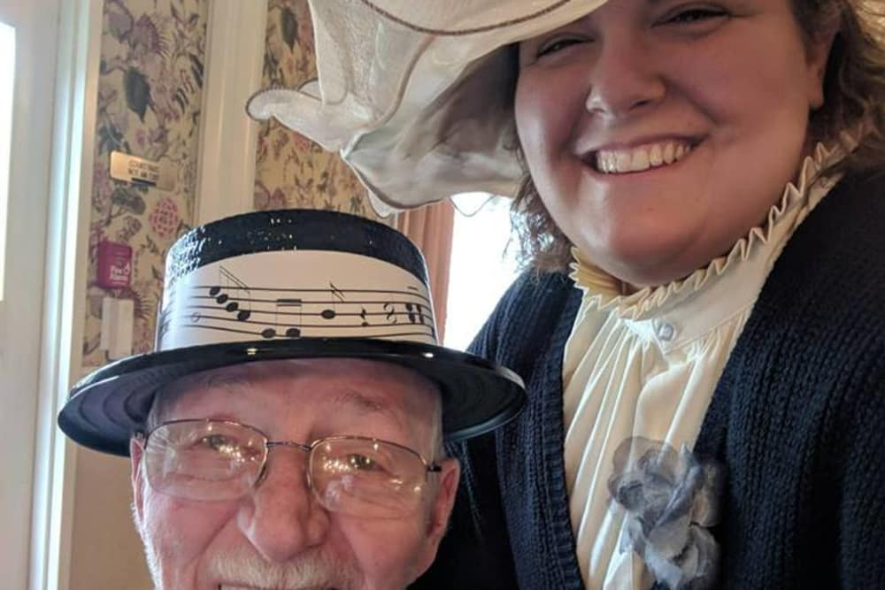A resident and caretaker dressed up for a themed day at Covered Bridge Health Campus in Seymour, Indiana