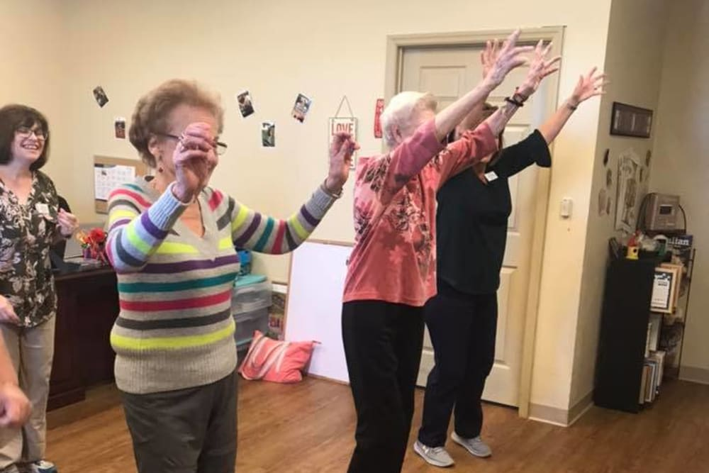 Residents exercising at Oak Pointe of Warrenton in Warrenton, Missouri