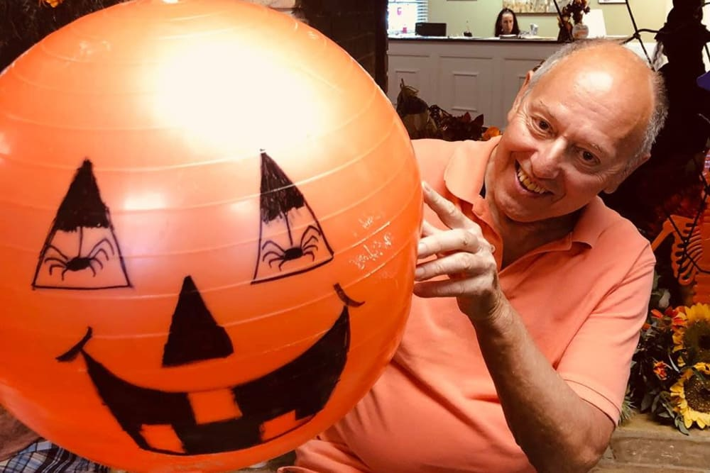 A resident making Halloween decorations at Bayside Terrace in Pinellas Park, Florida