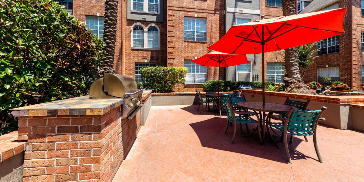 Outdoor patio with gas grills at Marquis on Pin Oak in Houston, Texas