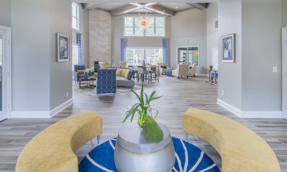 View of the resident clubhouse lounge area from the lobby entrance at 200 East in Durham, North Carolina