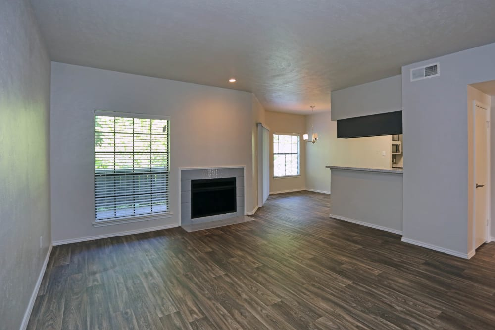 Living room with wood style flooring at 1303 Main in Duncanville, Texas