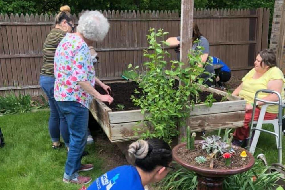 Residents gardening at Birch Creek in De Pere, Wisconsin