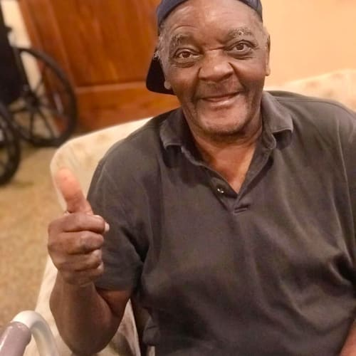 Resident Giving a thumbs up and smiling at Oxford Glen Memory Care at Carrollton in Carrollton, Texas