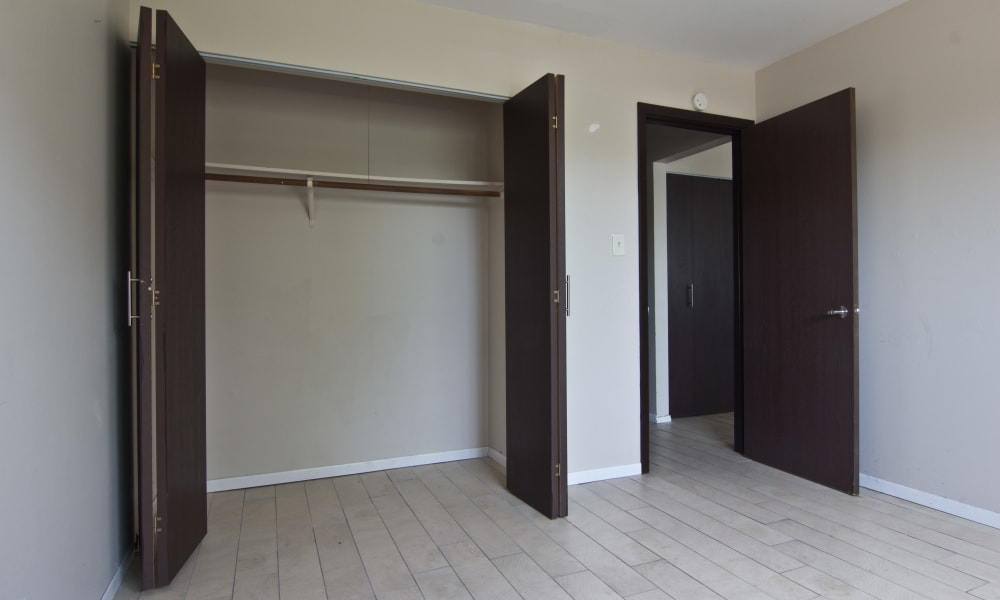 Inviting bedroom with plenty of closet space at The Flats at Gladstone