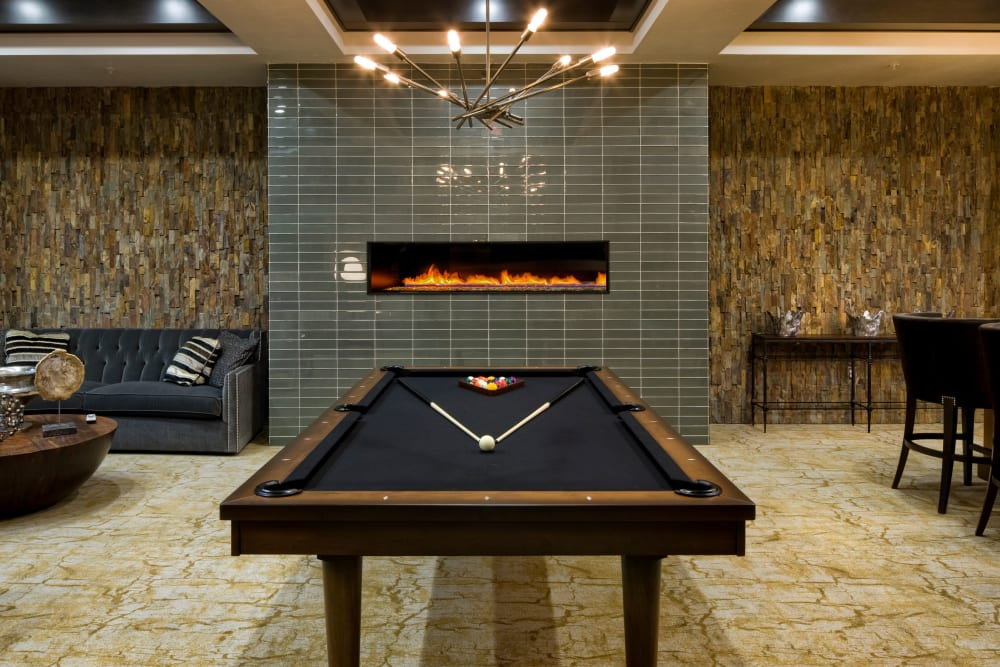 Community lounge with pool table and fireplace at Olympus Alameda in Albuquerque, New Mexico