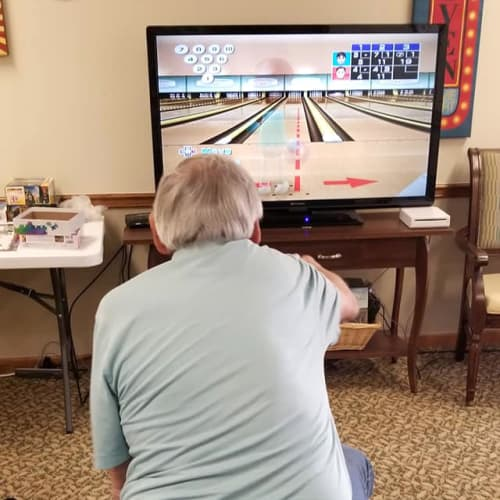 Resident playing wii bowling at Creekside Village in Ponca City, Oklahoma