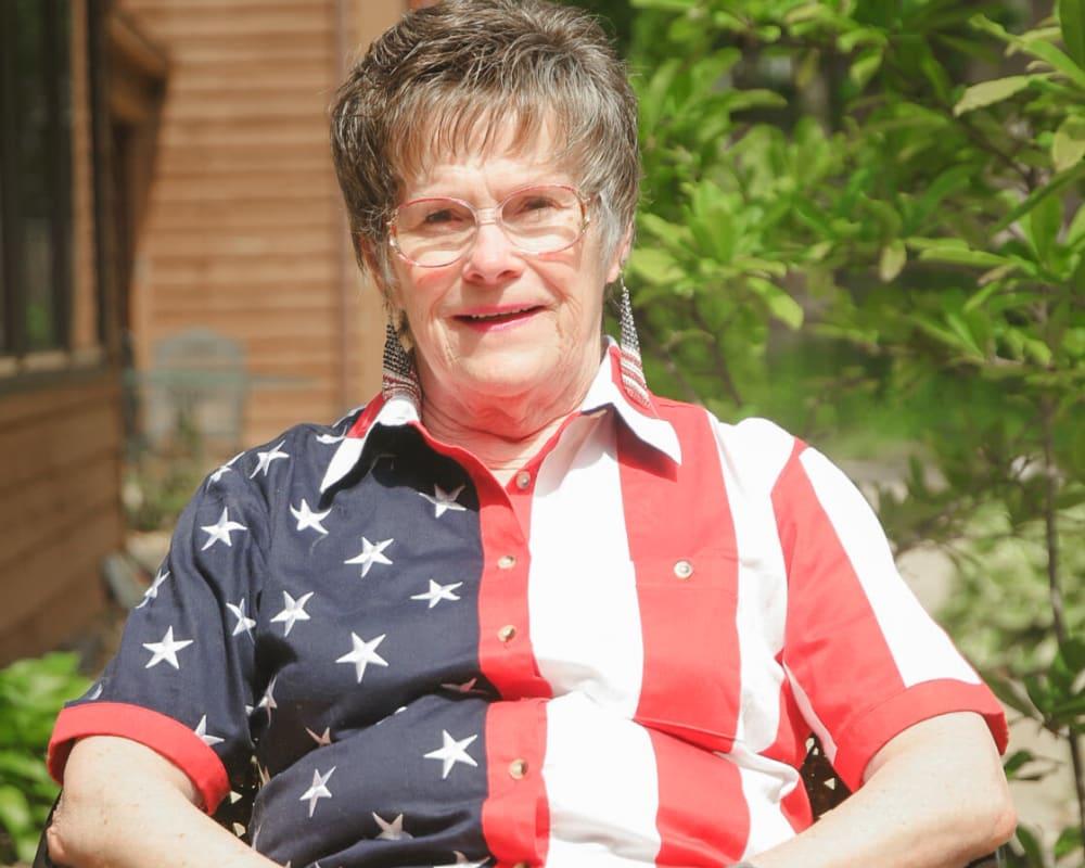 Resident enjoying the sun porch at Garnett Place in Cedar Rapids, Iowa.