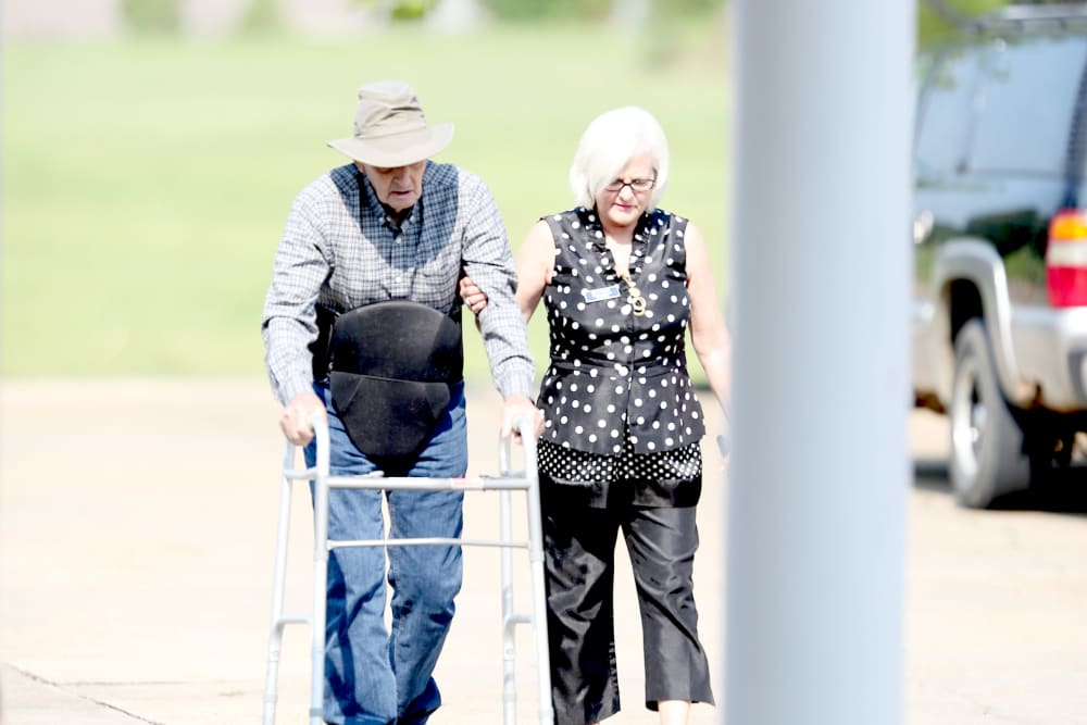 Resident and staff member out for a walk outside at Providence Assisted Living in Batesville, Mississippi.