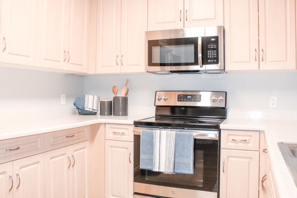 Gourmet kitchen with stainless-steel appliances at K Street Flats Apartment Homes in Berkeley, California