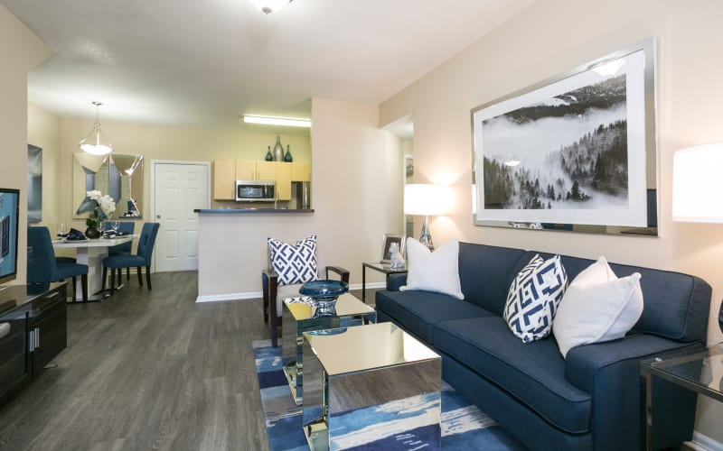 Spacious and bright living room, dining room and kitchen at Crestone Apartments in Aurora, Colorado