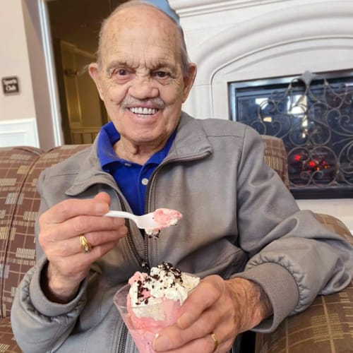 Smiling resident eating ice cream at FountainBrook in Midwest City, Oklahoma