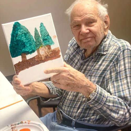 Resident showing his painting at FountainBrook in Midwest City, Oklahoma