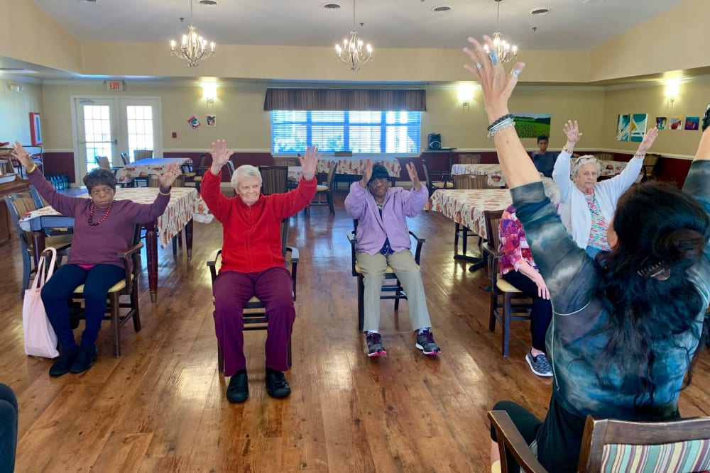 Residents stretching at Magnolias of Chesterfield in Chester, Virginia