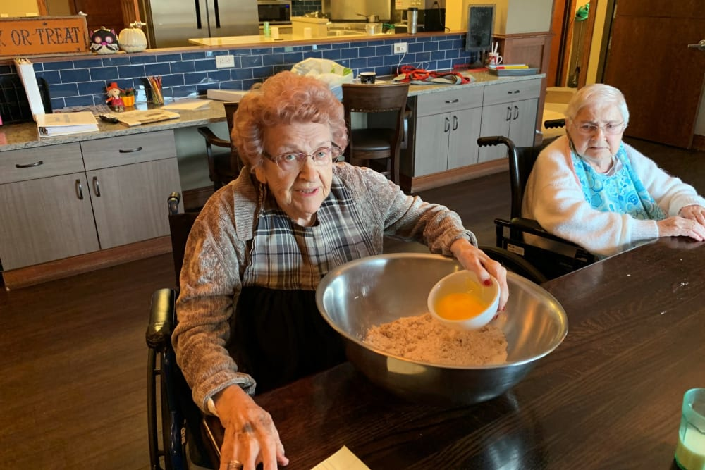 A resident baking some food at Water's Edge in Mankato, Minnesota