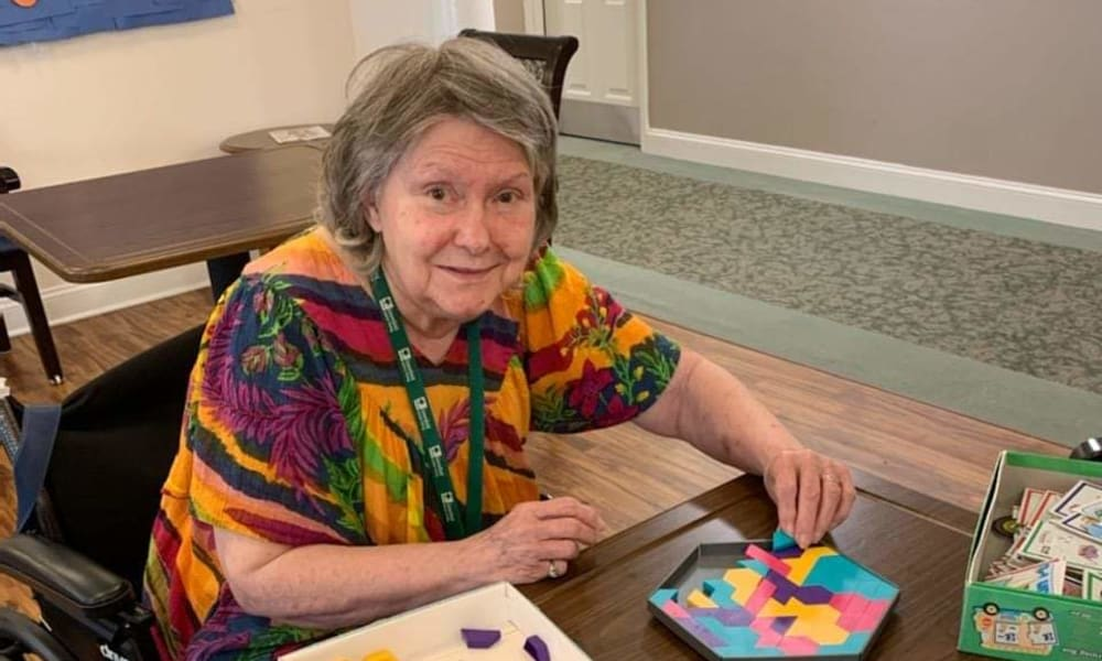 A resident playing a game at Traditions of Lansdale in Lansdale, Pennsylvania
