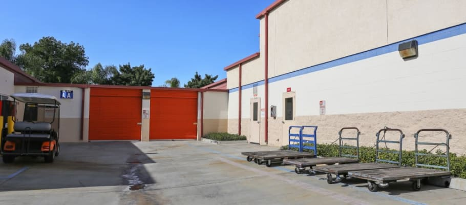 Outside storage units and large carts at A-1 Self Storage in Fullerton, California