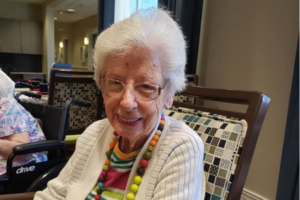 Smiling senior woman at Beach House Assisted Living & Memory Care at Wiregrass Ranch in Wesley Chapel, Florida