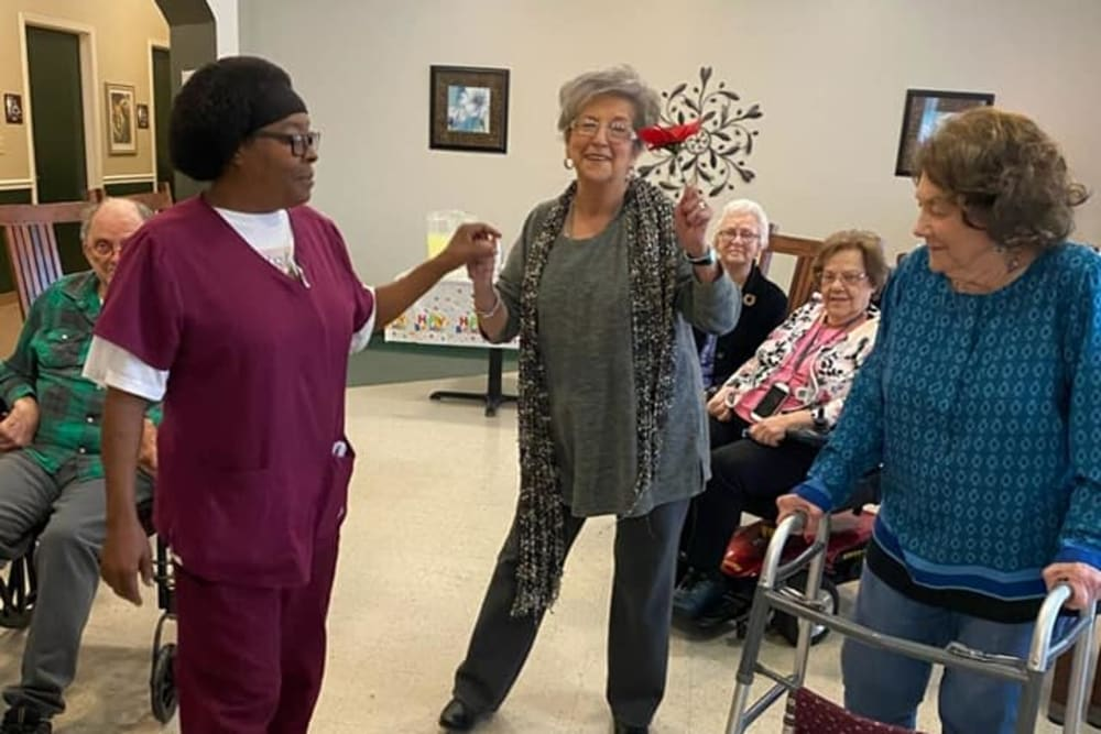 Residents dancing with caregivers at Rosewood Assisted Living in Lafayette, Louisiana