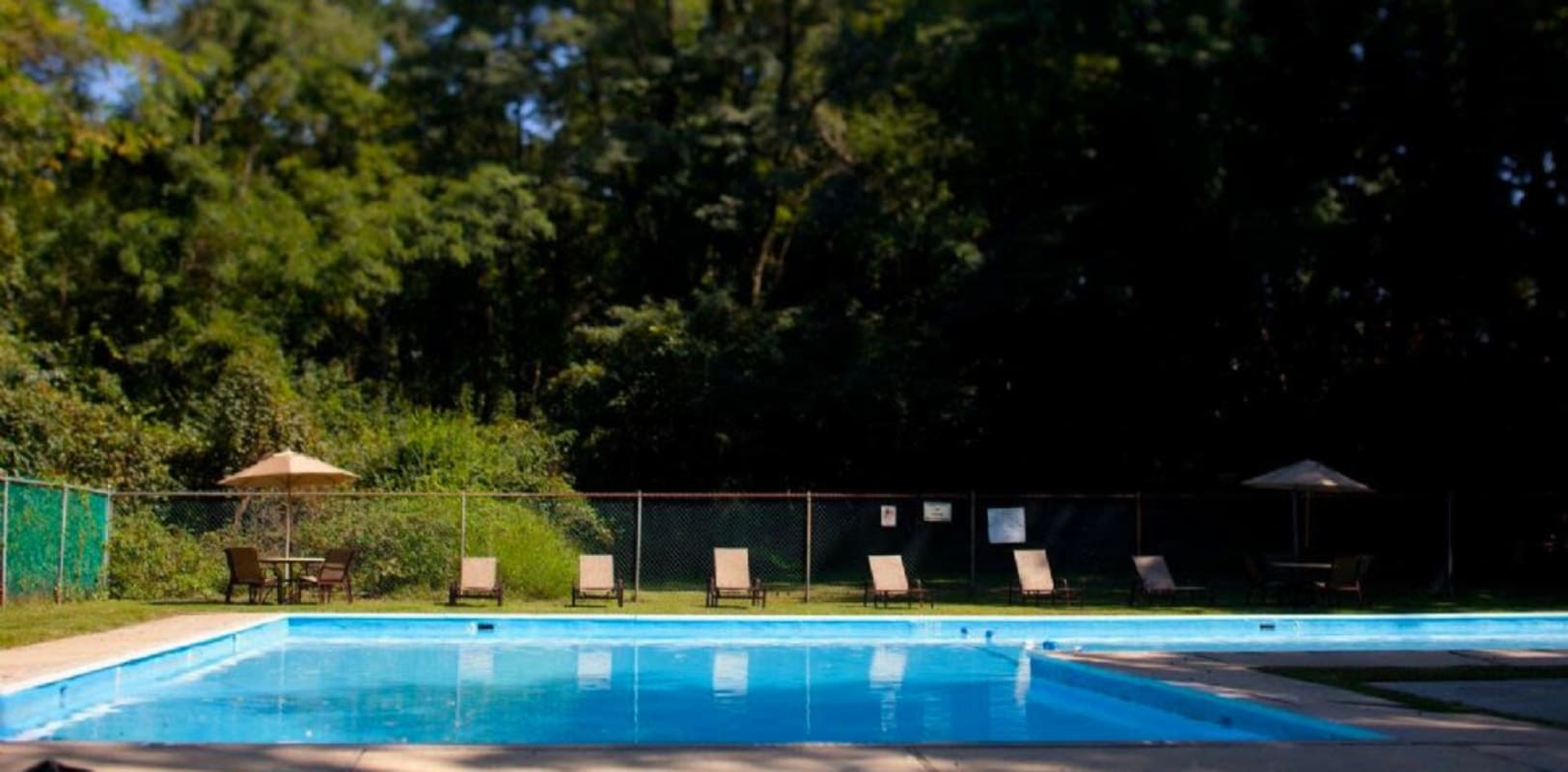 Refreshing swimming pool at Versailles Apartments in Ewing, New Jersey