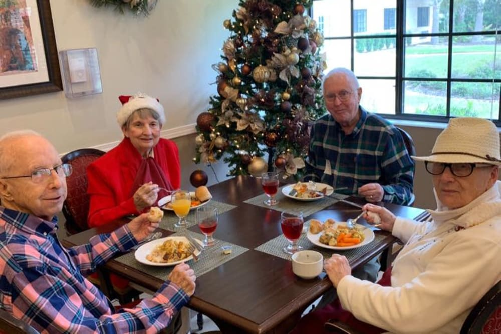 Residents enjoying a meal at Christmas at Inspired Living Sarasota in Sarasota, Florida.