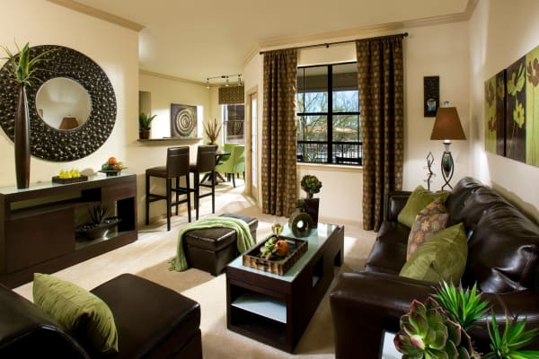 Spacious living room layout with autumn-toned furniture at Las Colinas at Black Canyon in Phoenix, Arizona