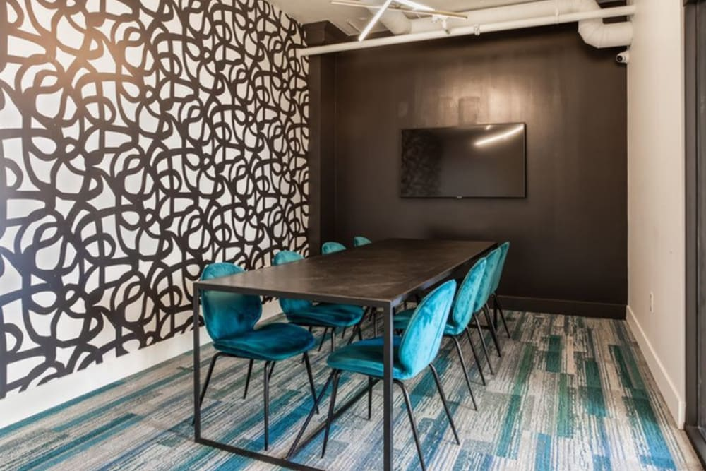 Meeting room with long table and screen at K Street Flats Apartment Homes in Berkeley, California