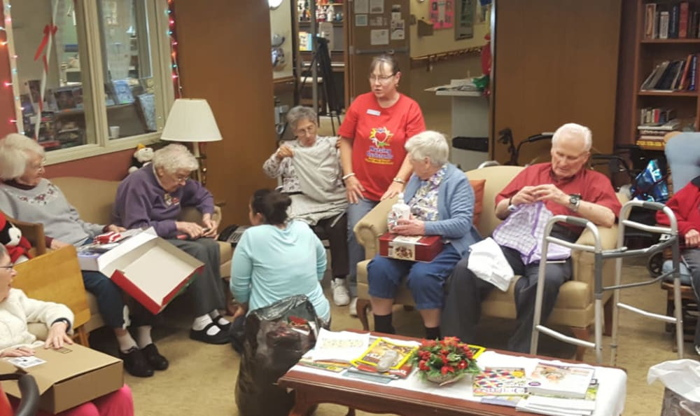 Residents open gifts during the holidays at Heritage Heights in Chelan, Washington