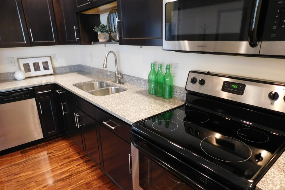Kitchen counters and modern appliances at The Reserve at 4th and Race in Cincinnati, Ohio