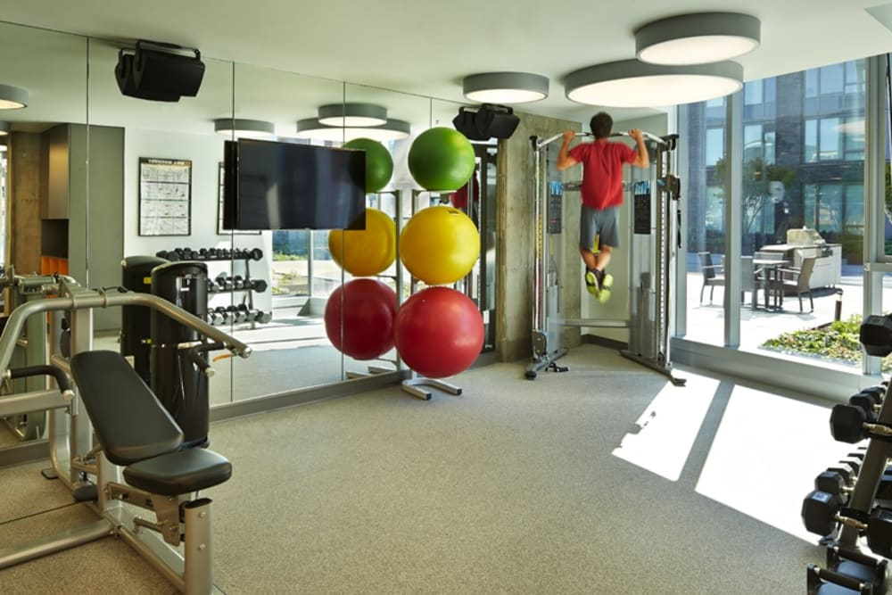 Well equipped fitness center for residents at The Nolo at Stadium Place in Seattle, Washington