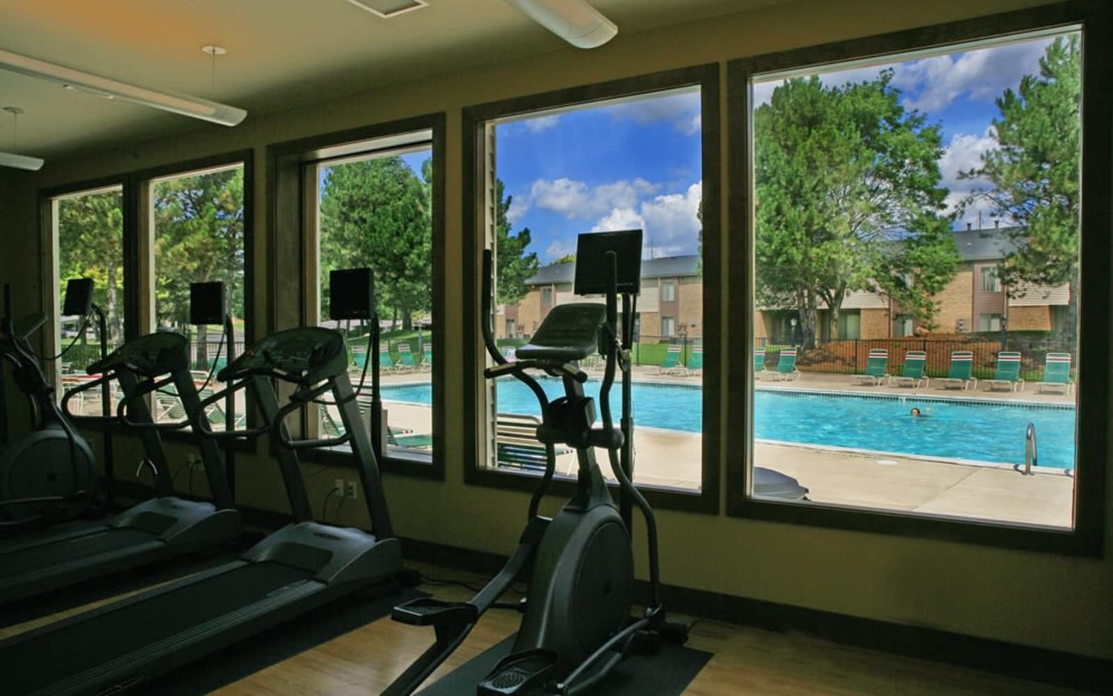 Fitness center and swimming pool at Fairmont Park Apartments in Farmington Hills, Michigan