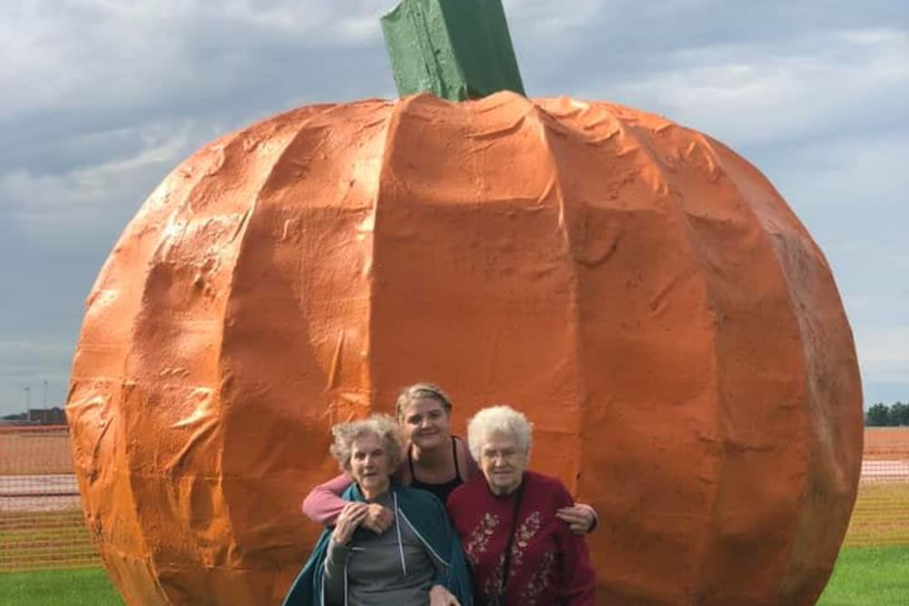 Residents in front of a giant pumpkin at Brentwood at LaPorte in La Porte, Indiana