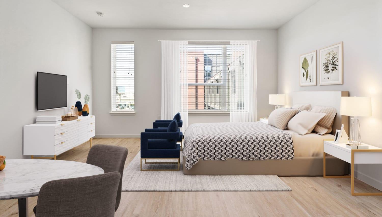 Model bedroom living room at Olympus on Broadway in Carrollton, TX